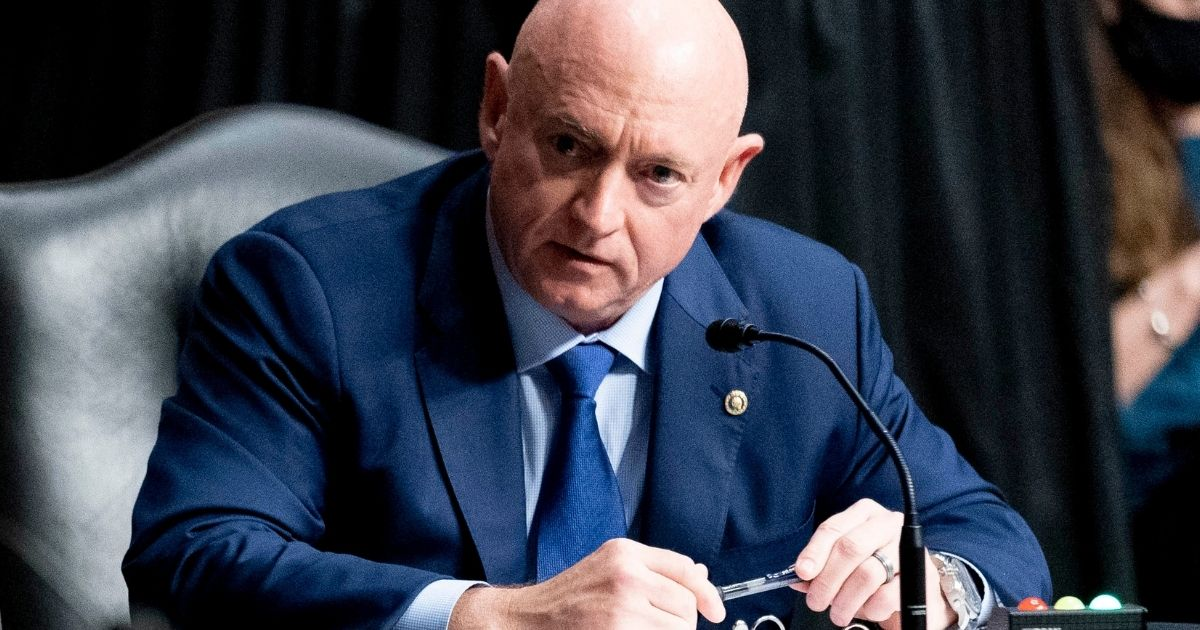 Democratic Sen. Mark Kelly of Arizona asks questions during a hearing on Capitol Hill in Washington on March 25.