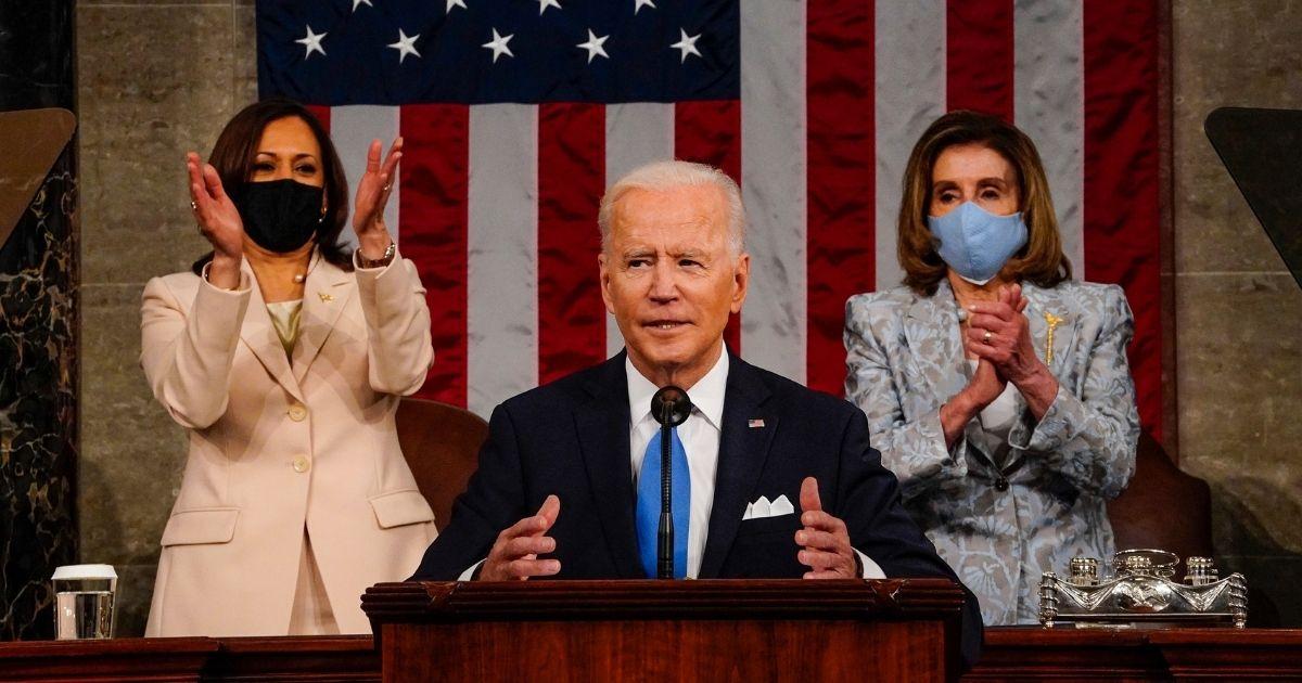 President Joe Biden addresses a joint session of Congress onWednesday, with Vice President Kamala Harris and House Speaker Nancy Pelosi behind him.