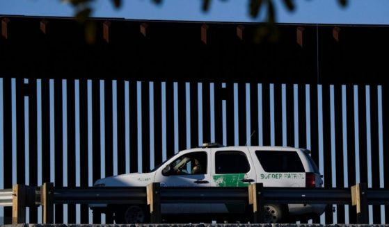 A Border Patrol agent sits in a vehicle along a border wall near the San Ysidro Port of Entry at the U.S.-Mexico border on Feb. 19, 2021, in San Diego.