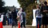 People wait in line for more than an hour to vote at Dan Ruiz Branch Library on Nov. 3, 2020, in Austin, Texas.